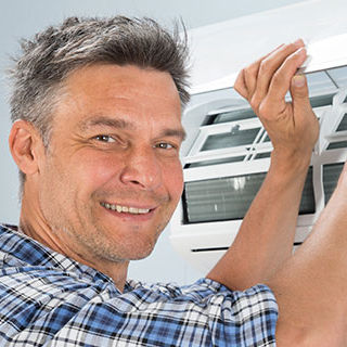 Technician Fixing Air Condition Unit - Lead Image for HVAC Page