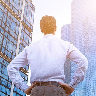 Business Man Facing Tall Building - Lead Image for Lessors Risk Page