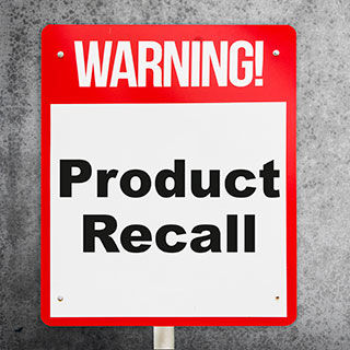 Red and White Warning Sign - Lead Image for Product Liability Insurance Page