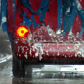 Red Car Being Washed - Lead Image for Car Washes Page