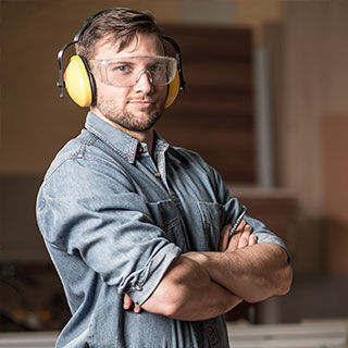 Male Carpenter Wearing Protective Gear - Lead Image for Carpenters Page