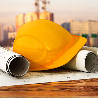 Inszone Insurance Construction Page Banner - Construction Safety Hat and Blueprints on Table