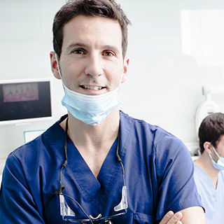 Dentist with Dental Nurses and Patient - Lead Image for Dentist Office Page
