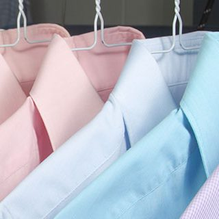 Colorful Formal Shirts on Hangers - Lead Image for Dry Cleaners Page