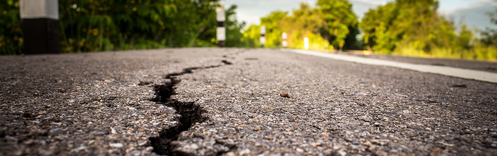 Inszone Insurance Earthquake Insurance Page Banner - Cracked Road