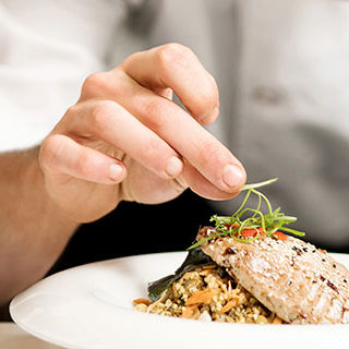 Chef Arranging Food on Plate - Lead Image for Fine Dining Page
