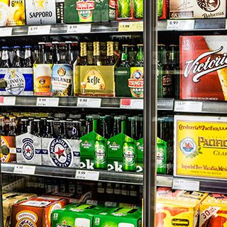 Various Alcoholic Drinks Displayed on Shelf - Lead Image for Liquor Stores Page