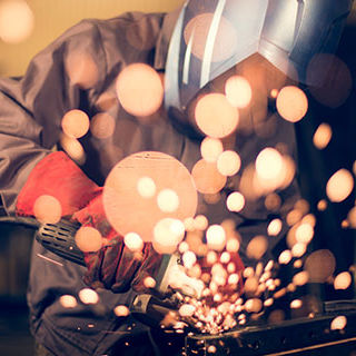 Worker Using Angle Grinder - Lead Image for Manufacturing Page