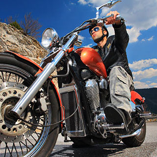 Inszone Insurance Motorcycle Insurance Page Banner - Male Driver Riding a Motorycle