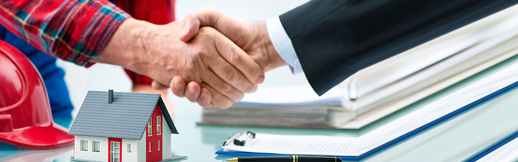 Inszone Insurance Property Insurance Page Banner - Corporate Man Shaking Hands with Man with Safety Hat