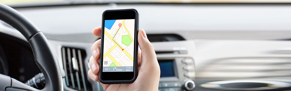 Driver Using Navigation Map on Mobile Device - Lead Image for Taxi & Ride Share Services Page