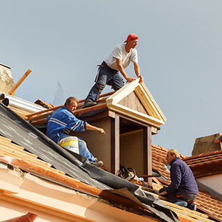 Construction Workers Building a Roof - Lead Image for Roofers Page