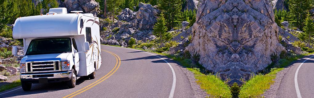 Inszone Insurance RV Insurance Page Banner - Vehicle Cruising Mountain Highway