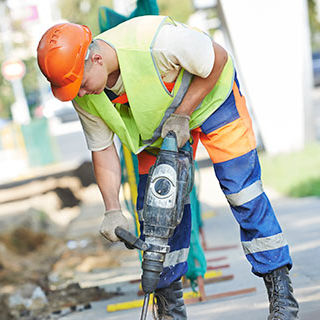 Male Worker Using a Jack Hammer Drill - Lead Image for Street and Road Construction Page