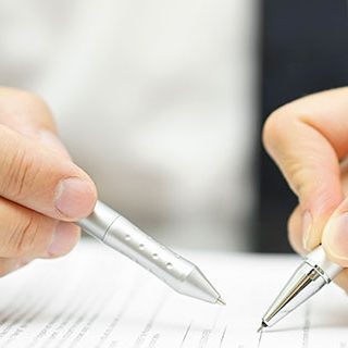 Inszone Insurance Surety Bonds Page Banner - Two Corporate People Signing on Paper