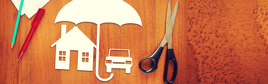 Inszone Insurance Umbrella Insurance Page Banner - Scissors, Pens and Cut Outs on Table