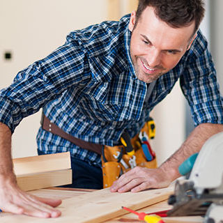 Inszone Insurance Workers Compensation Insurance Page Banner - Male Construction Worker Using Construction Tools