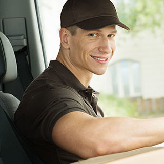 Male Delivery Driver Sitting in the Car - Lead Image for Delivery and Courier Page