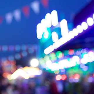 Blurry Amusement Park Image at Night - Lead Image for Fairs and Carnivals Page