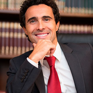 Male Wearing Corporate Attire Smiling - Lead Image for Professional Services Page