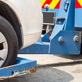 Tow Truck Towing a Vehicle - Lead Image for Tow Services Page