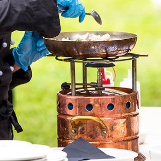 Man Cooking Using Portable Cooker - Lead Image for Vendors Page