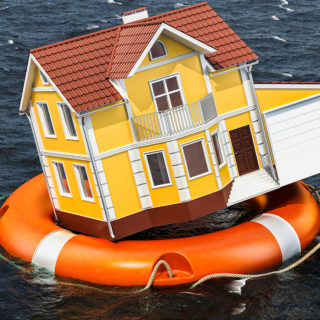 Model House on a Lifebuoy Ring - Banner Image for How to Survive a Flood: Flood Safety Tips Blog